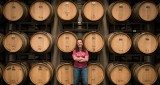 Jenne Baldwin-Eaton, winemaker at Plum Creek Winery, guard her barrels full of wine.