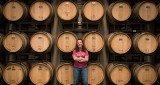 Jenne Baldwin-Eaton, winemaker at Plum Creek Winery, guard her barrels full of wine.